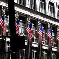 Photo of row of US flags outside building | Lonsdale Insurance Brokers | North American Property & Casualty