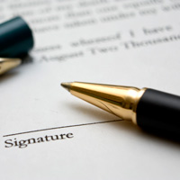 Photo of pen resting on contract | Lonsdale Insurance Brokers | Professional Liability