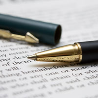 Photo of pen resting on document | Lonsdale Insurance Brokers | Reinsurance and Special Risks Division