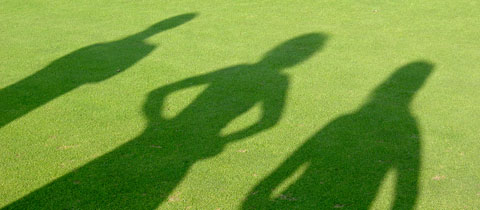 Photo of group of shadows on grass | Lonsdale Insurance Brokers | Staff Directory